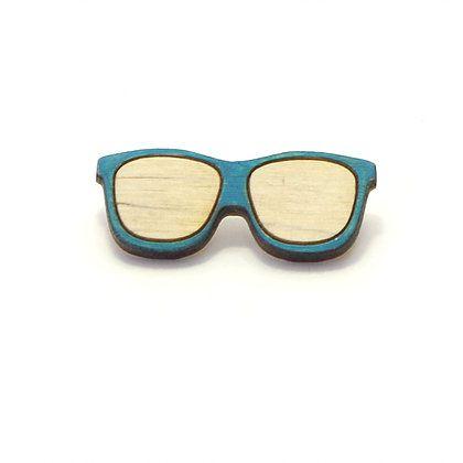 Значок Очки голубыеПодарки<br>Деревянный значок, ручная роспись и удивительно милый дизайн.<br>Размер: 10 х 15 см; Объем: None; Материал: Дерево; Цвет: Голубой;