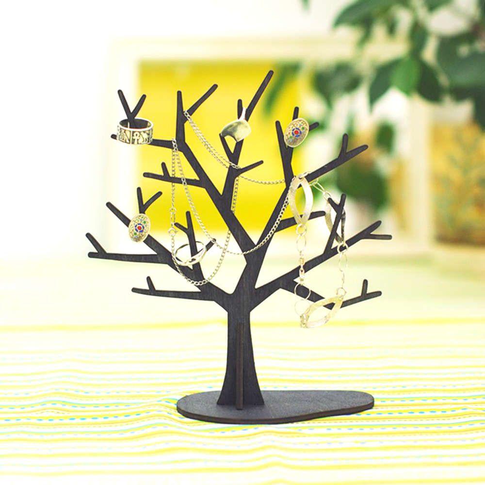 Держатель для мелочей ДеревоДевушке<br>Держатель для мелочей в виде маленького дерева.<br>Размер: 18 х 20 х 8 см; Объем: None; Материал: Дерево; Цвет: Черный;